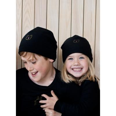 Must müts Karu